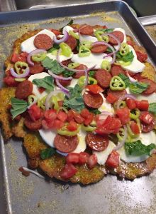 summer squash pizza crust with toppings added, before final baking.